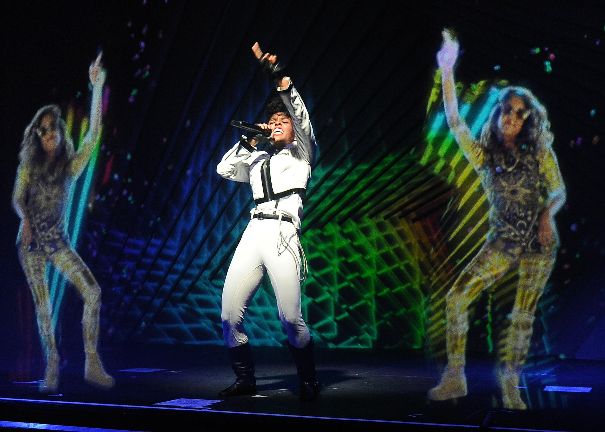 Janelle Monae, center, performs alongside holograms of M.I.A. during a launch party for the Audi M3 on April 3, 2014.
