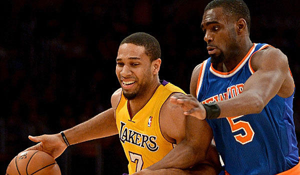 Xavier Henry battles the New York Knicks' Tim Hardaway Jr.