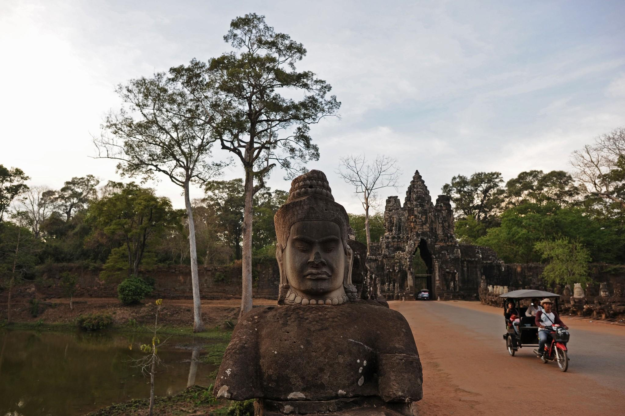 A tuk-tuk bicycle cab takes tourists around Cambodia's ancient city of Angkor Thom, part of the Angkor architectural complex that Google Maps has digitally mapped for the first time and made available online through its World Wonders Project.