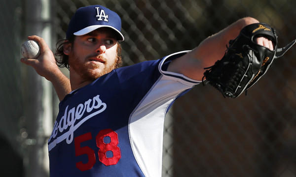 Dodgers pitcher Chad Billingsley throws during a spring training practice session on Feb. 10. Billingsley begins his minor-league rehabilitation assignment on Sunday.