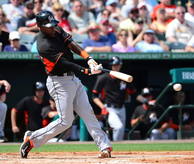 Miami Marlins shortstop Adeiny Hechavarria (3) hits an rbi double against the St. Louis Cardinals at Roger Dean Stadium. The Marlins defeated the Cardinals 7-3.