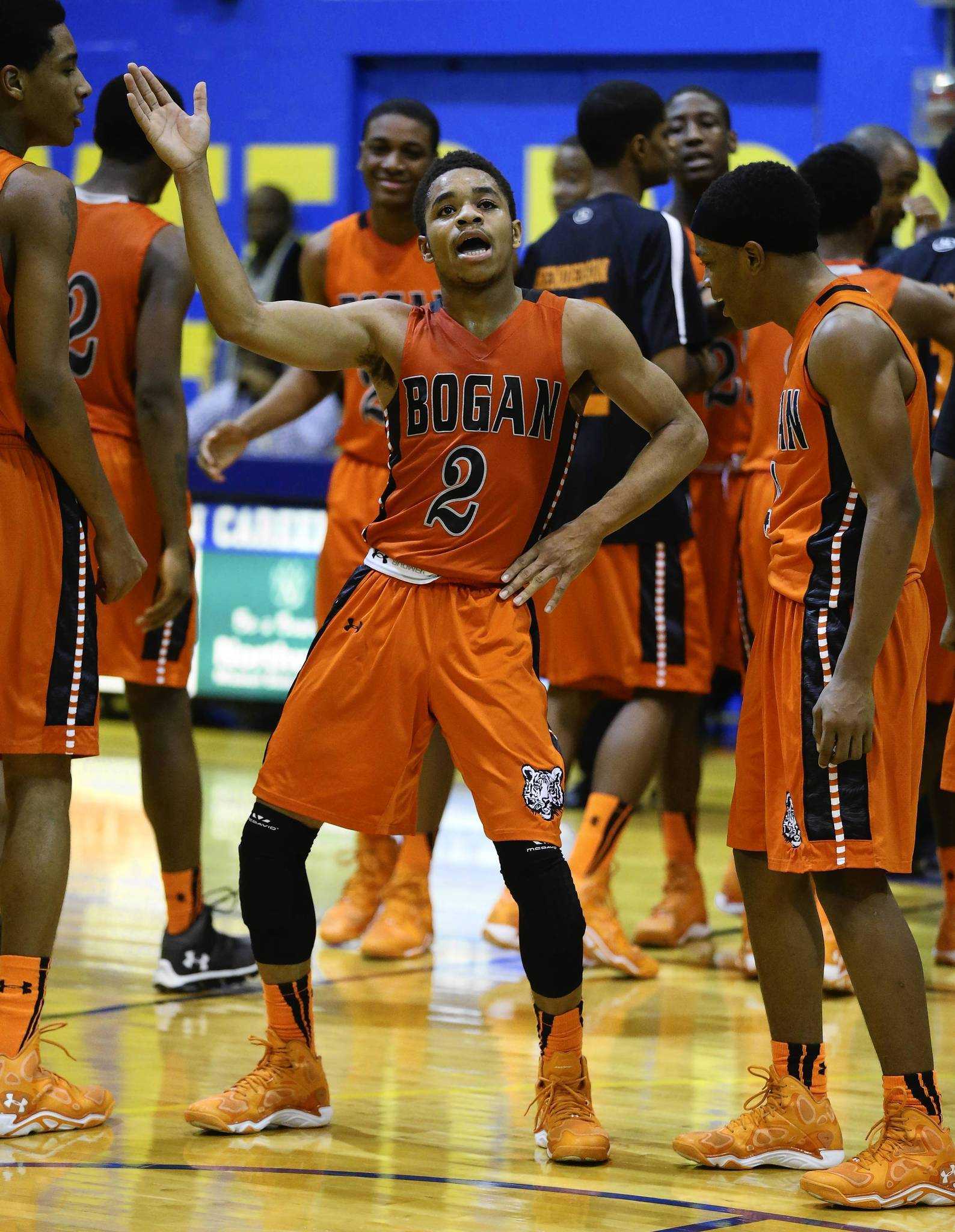 Bogan's Luwane Pipkins (third team) dances after a 59-51 win over Simeon on Tuesday, Jan. 14, 2014.