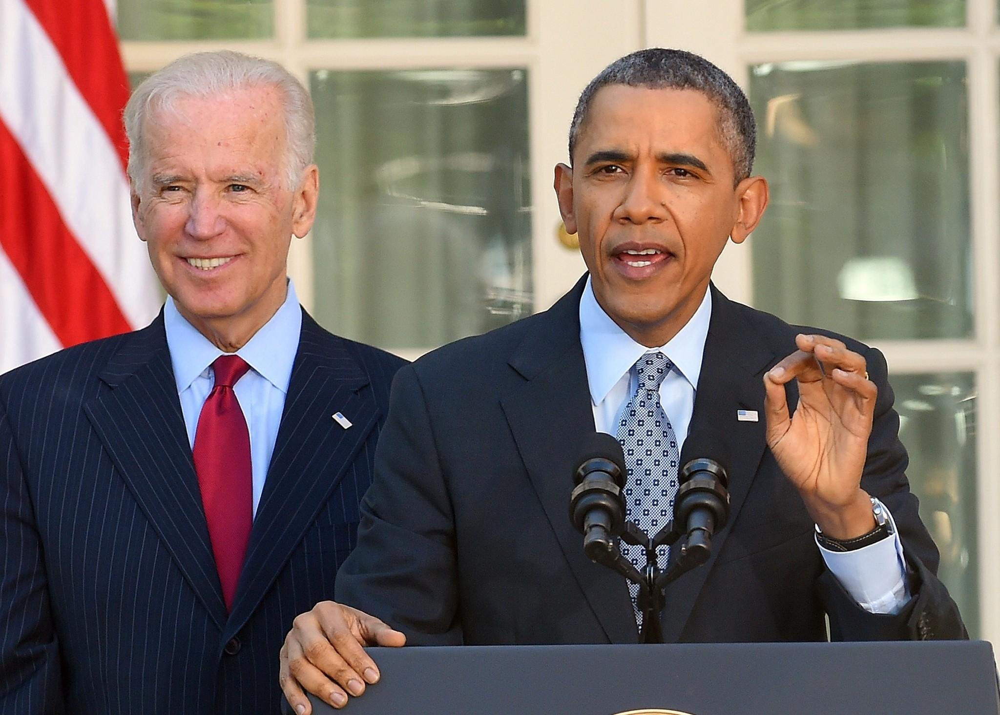 President Barack Obama is accompanied by Vice President Joe Biden as he delivers a statement on the Affordable Care Act at the Rose Garden of the White House in Washington, DC. Obama cheered seven million people who signed up for insurance under his healthcare law, and lashed out at political foes who he said were bent on denying care to Americans.