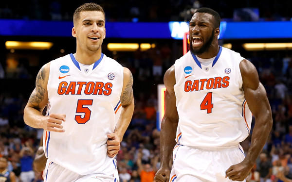 Center Patric Young (4) and point guard Scottie Wilbekin (5 ) form a stellar inside-out combination for Florida. They are two of four seniors in the starting lineup.