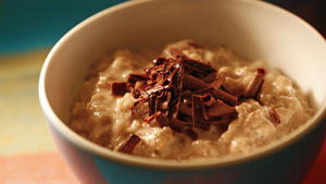 Vegan hazelnut rice pudding with orange and dark chocolate