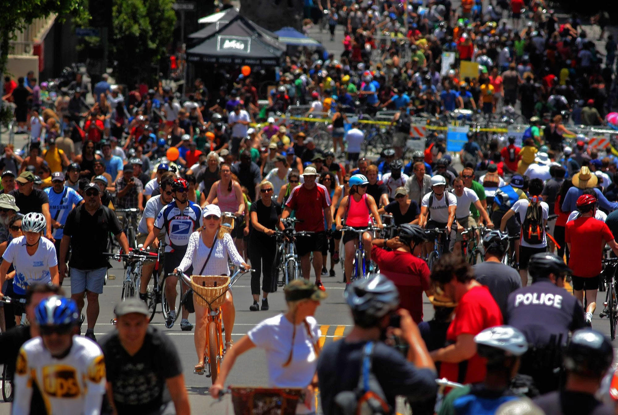 Hundreds of cyclists make their way along Wilshire Boulevard during a  CicLAvia event in June 2013