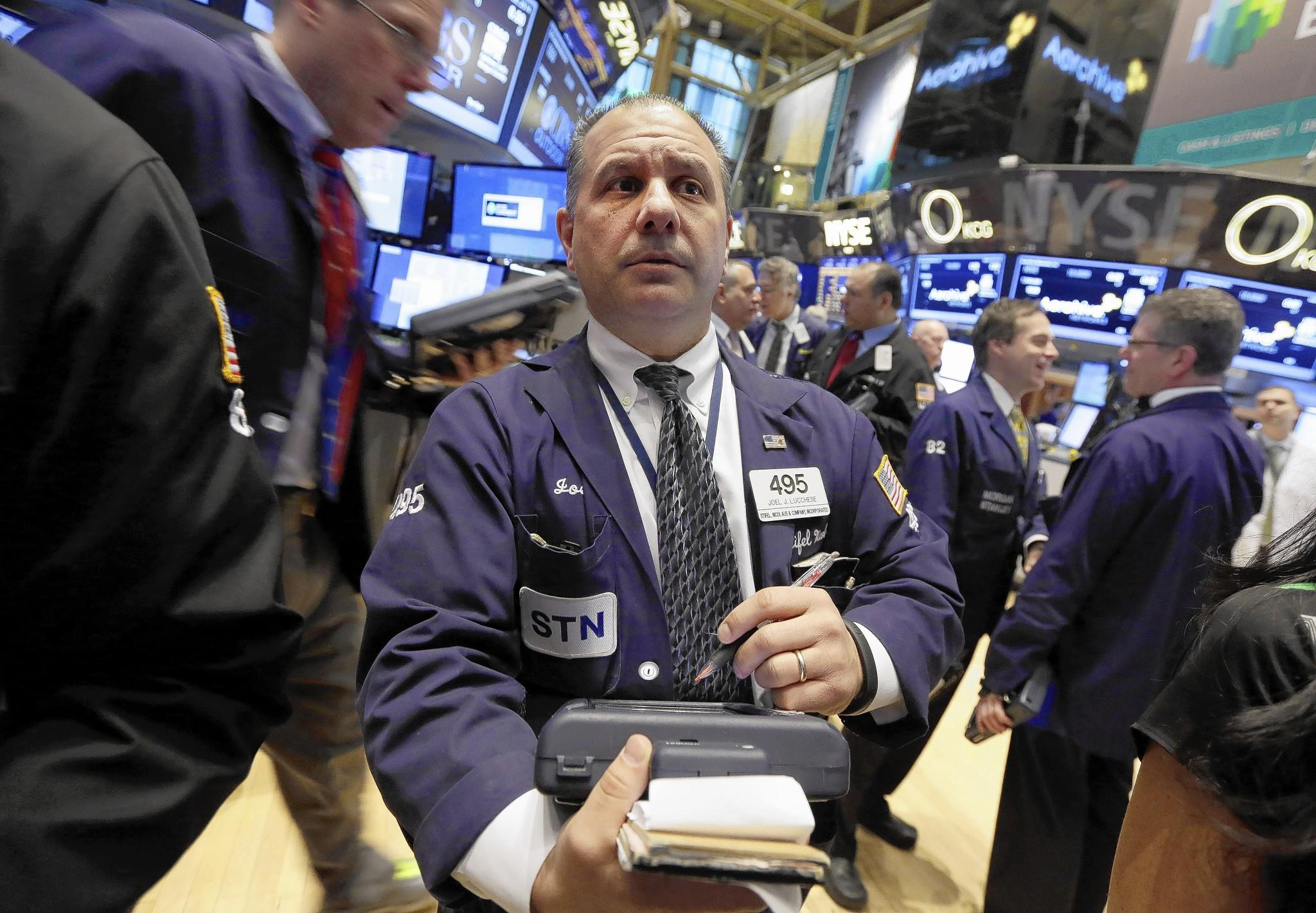 Stocks tumbled Friday, but the S&P 500 still is up 1% this year after bolting nearly 30% last year. Above, traders on the floor of the New York Stock Exchange.