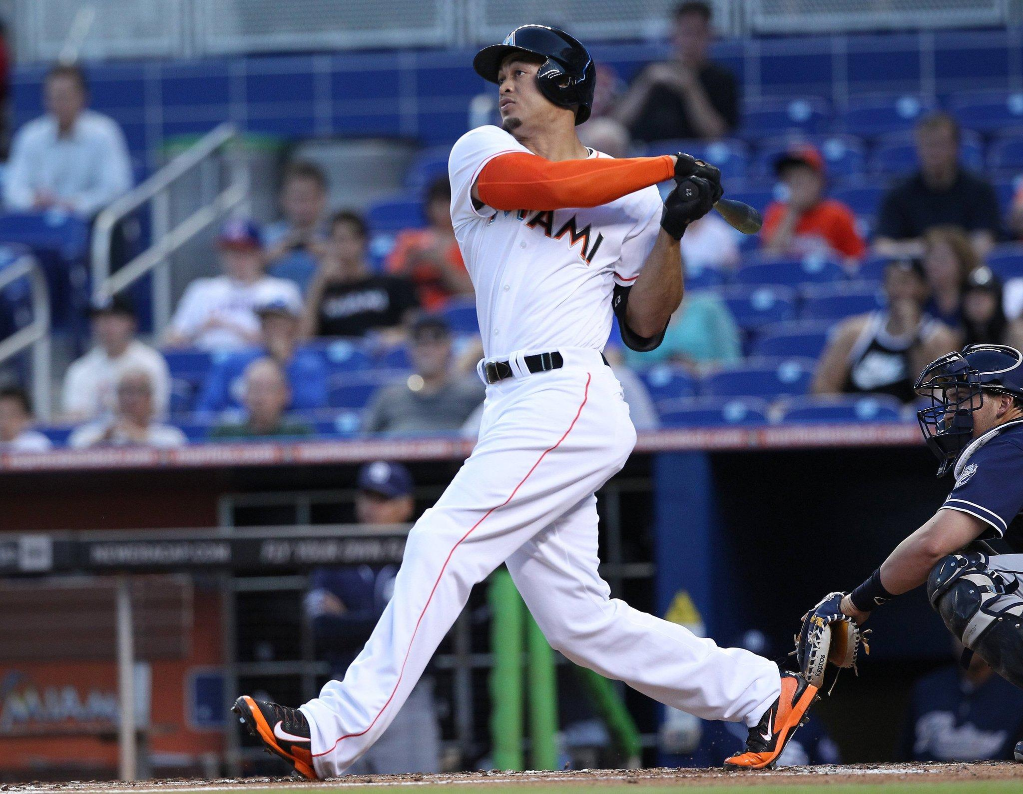 The Miami Marlins' Giancarlo Stanton hits a two-run home run in the first inning against the San Diego Padres on Friday, April 4, 2014, at Marlins Park in Miami. (David Santiago/El Nuevo Herald/MCT)