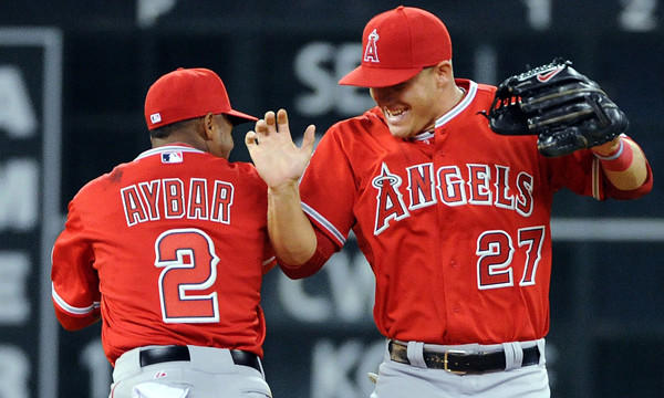 Angels teammates Erick Aybar, left, and Mike Trout celebrate the team's 11-1 road victory over the Houston Astros on Friday.