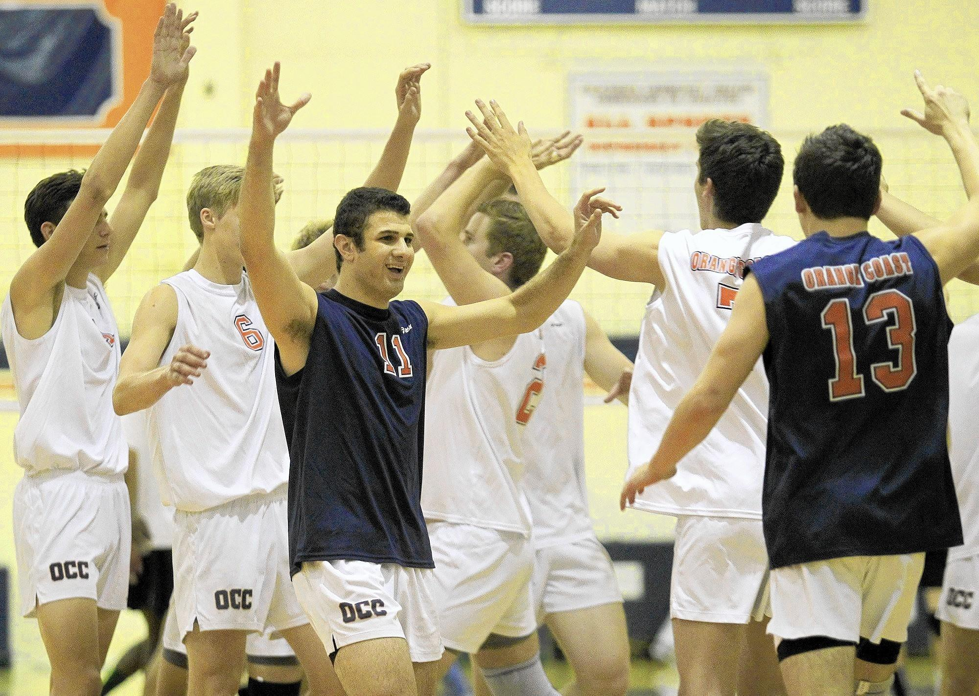 Orange Coast College mens' volleyball players react after beating Grossmont in four sets in a Pacific Coast Conference match on Friday.