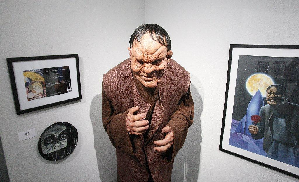Artwork in the Creature Feature Gallery at Creature Features in Burbank on Friday, April 4, 2014. The store closed 10 years ago to go into a mail order business, and reopened recently on Magnolia where they feel the area is strong for creepy culture. (Tim Berger/Staff Photographer)
