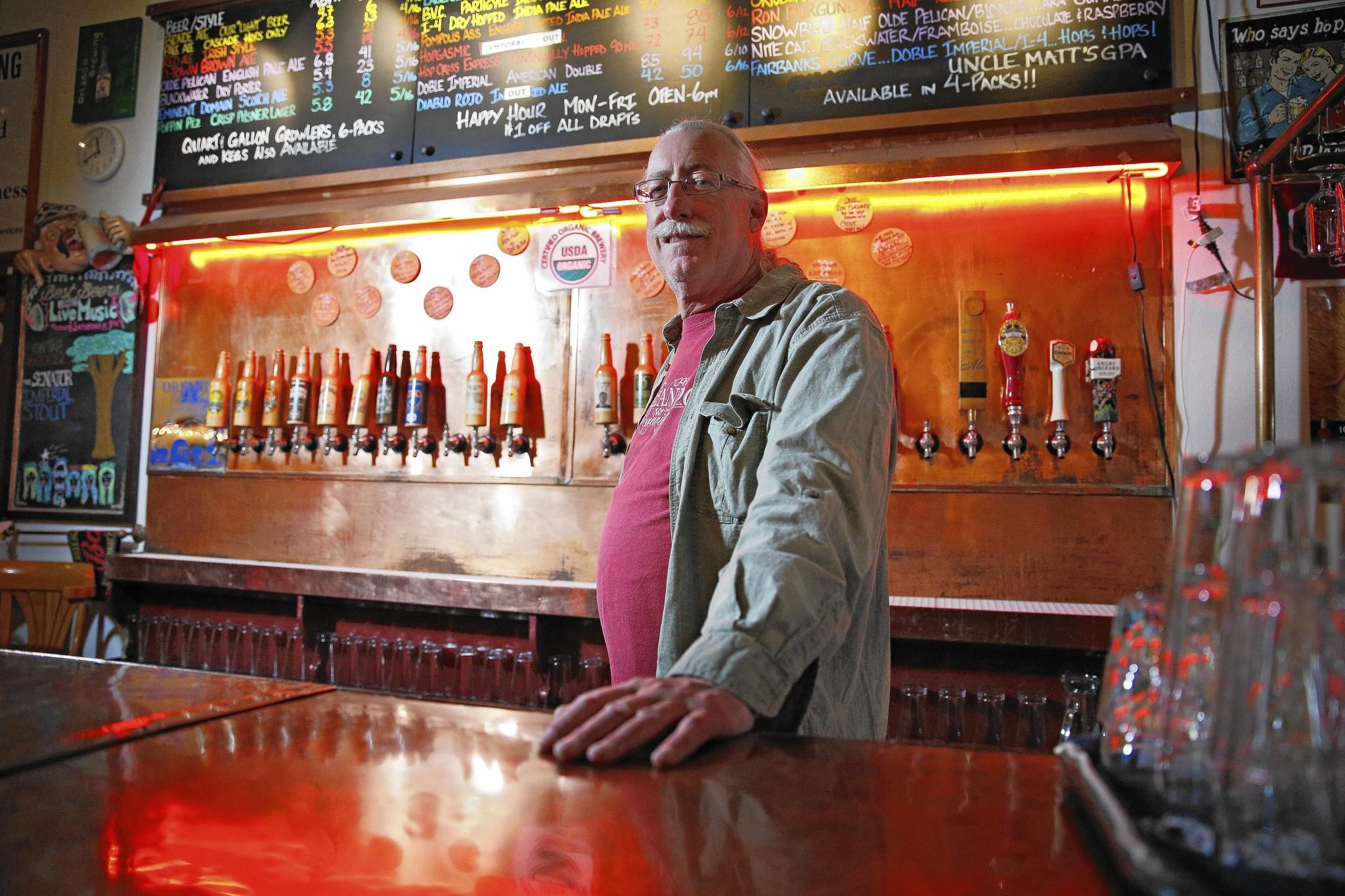 John Cheek, President of Orlando Brewing, is fighting against proposed legislation in Tallahassee that he believes benefits large brewers and distributors at the expense of microbreweries. Orlando Brewing's Brewery and Taproom in Orlando, Fla. Friday, March 28, 2014.