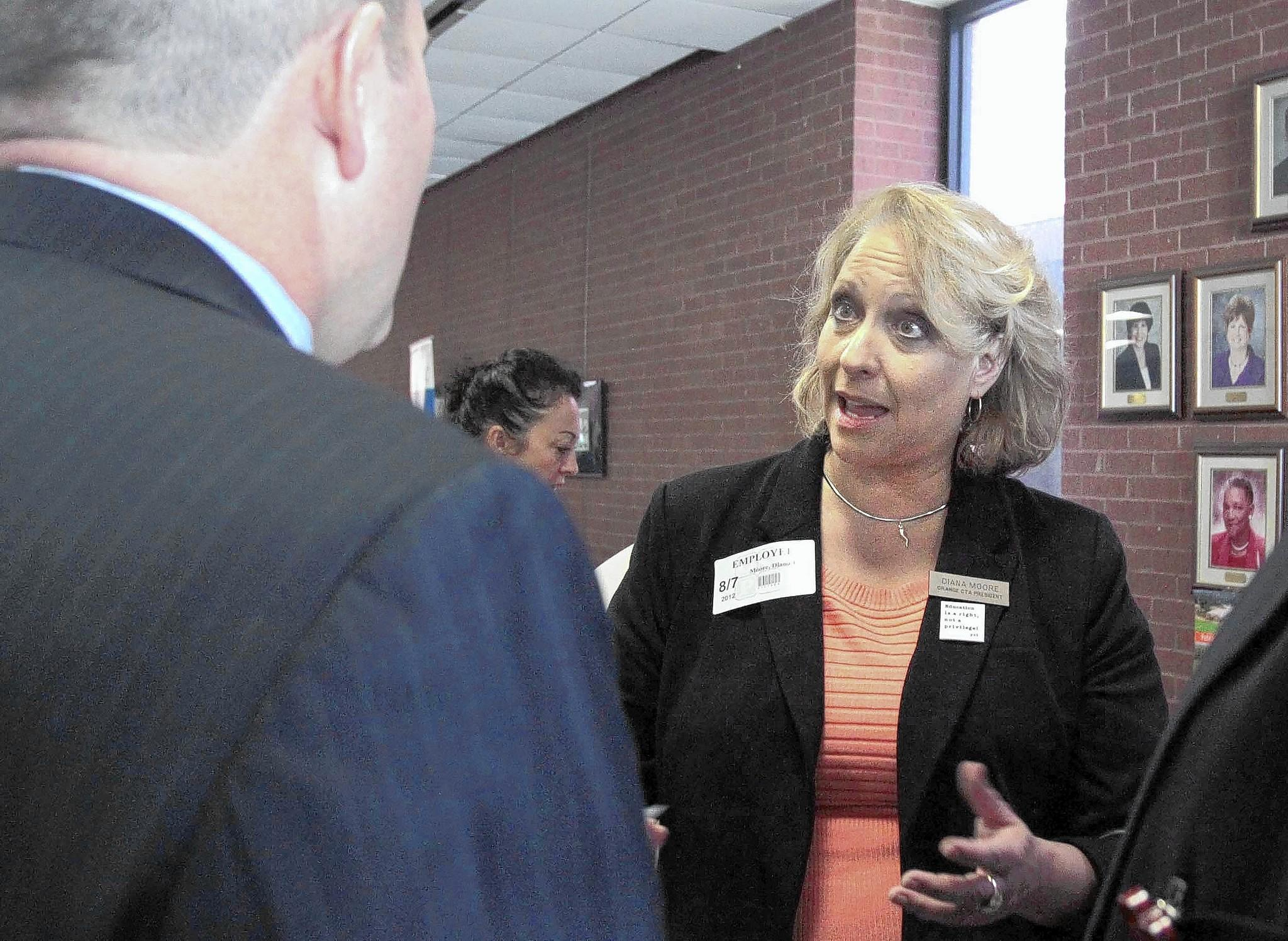 New Orange CTA president Diana Moore talks with Orange County Public School's Scott Howat.