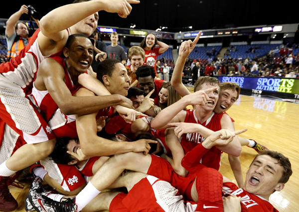 Mater Dei players celebrate after their 71-61 victory over Bishop O' Dowd in the Open Division state championship game.