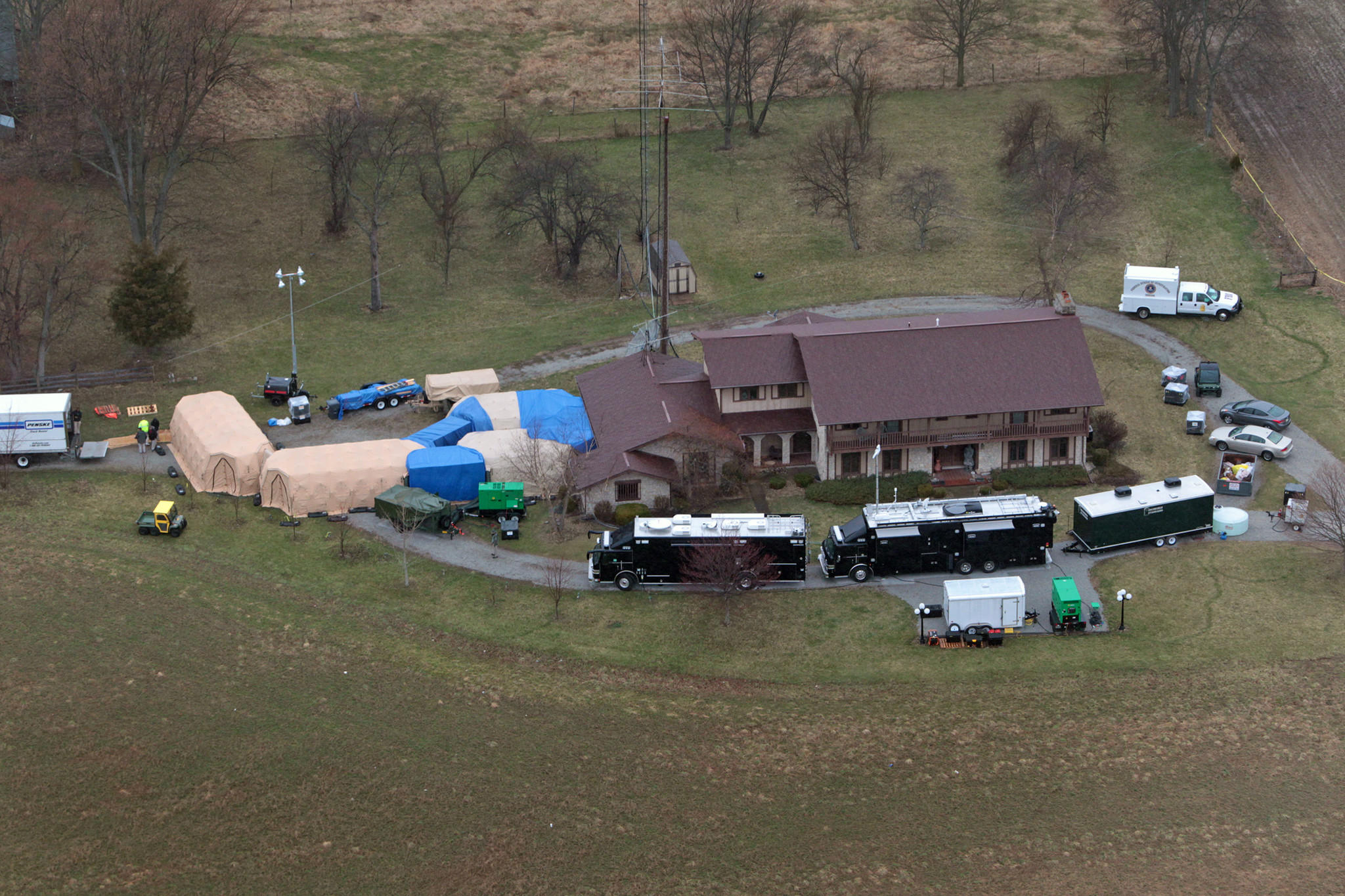 "In this aerial photo taken from WTHR Chopper 13, FBI agents work around the home of 91-year-old Donald Miller in Waldron, Ind. Authorities seized thousands of Native American, Russian, Chinese and other artifacts that have ""immeasurable"" cultural value from Miller's private collection, the FBI said."