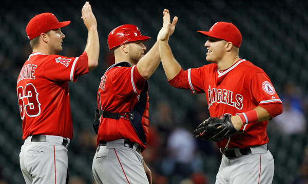 Angels center fielder Mike Trout, right, congratulates teammates Chris Iannetta, center, and Nick Maronde after the Angels' 11-1 win over the Houston Astros on Friday.