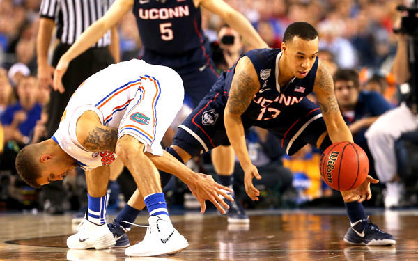 Connecticut guard Shabazz Napier comes up with a steal after Florida guard Scottie Wilbekin lost his dribble during their NCAA tournament semifinal game Saturday evening in Arlington, Texas.