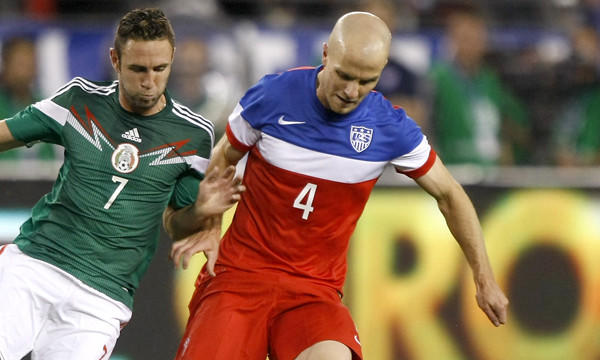 Mexico defenseman Miguel Mayun, left, and U.S. midfielder Michael Bradley compete for the ball during an international friendly match on Wednesday. Bradley dominated play in the first half of the game following a formation change by U.S. Coach Juergen Klinsmann.