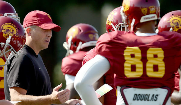 USC offensive coordinator and quarterbacks coach Clay Helton, shown at practice last season, guided USC to a Las Vegas Bowl victory over Fresno State in December as interim head coach before returning to his regular duties under new Coach Steve Sarkisian.