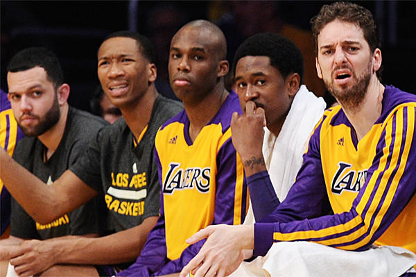 Jordan Farmar, Wesley Johnson, Jodie Meeks, MarShon Brooks and Pau Gasol don't like what they see while sitting on the Lakers bench during a 142-94 loss to the Clippers last month.