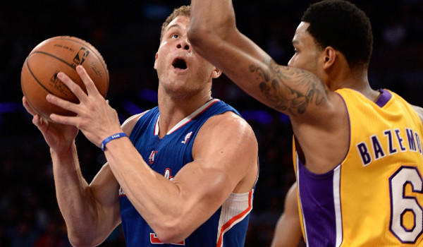 Lakers' Kent Bazemore guards Clippers' Blake Griffin last month at Staples Center.