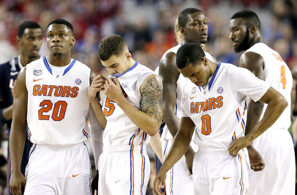 Florida players Michael Frazier II (20), Scottie Wilbekin (5) and Kasey Hill (0) react in the final moments of their Final Four loss to Connecticut on Saturday night.