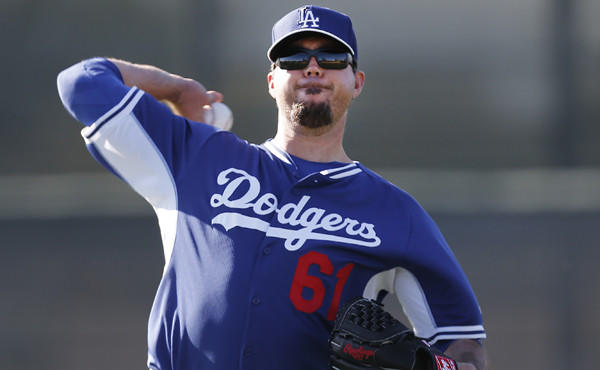 Dodgers pitcher Josh Beckett throws during a spring-training practice session in Glendale, Ariz., on Feb. 10. An ankle injury could derail Beckett's scheduled start Wednesday against the Detroit Tigers.
