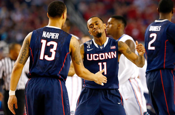 Connecticut guards Ryan Boatright (11) and Shabazz Napier celebrate as they close in on a victory over Florida in the NCAA Final Four on Saturday night at AT&T Stadium.