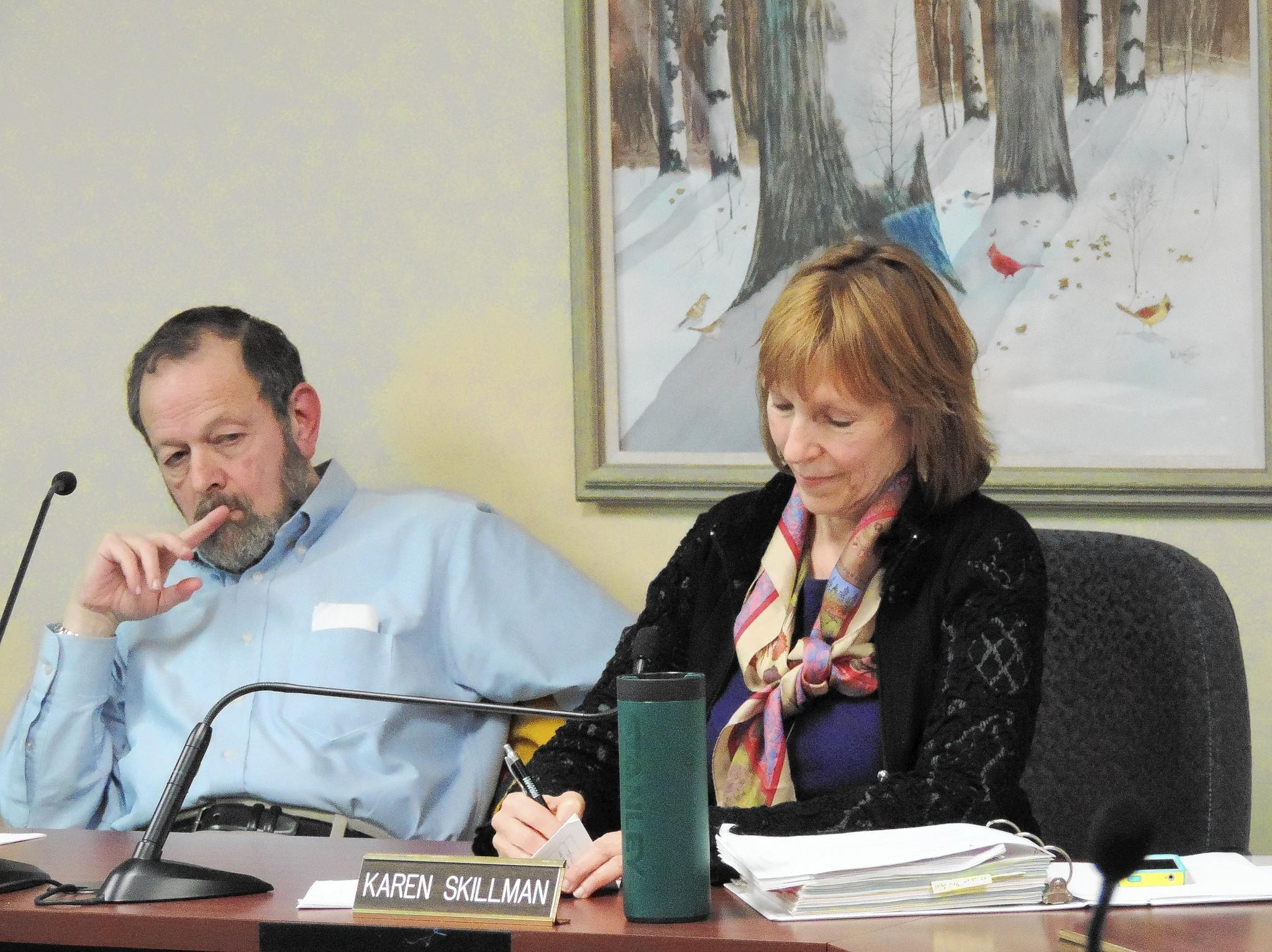 Plan Commission members Dennis Pines and Karen Skillman discuss a proposal for a shelter.