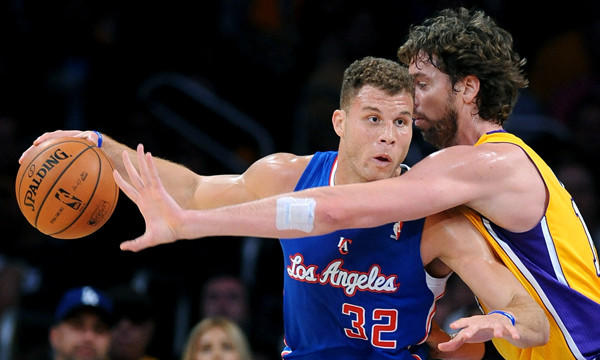 Lakers center Pau Gasol, right, tries to steal the ball from Clippers power forward Blake Griffin during the Lakers' season-opening win Oct. 29.