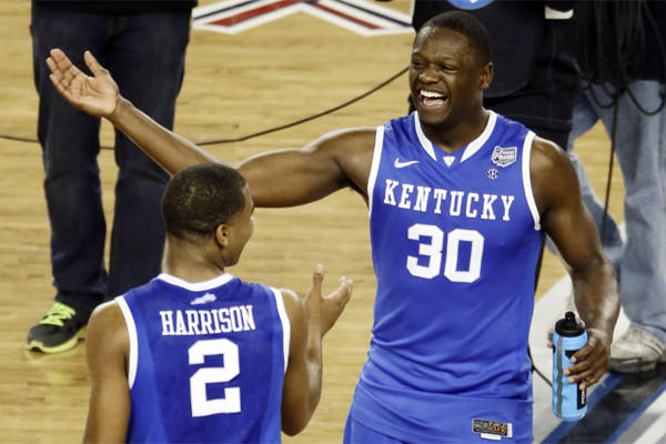 Julius Randle, right, celebrates with Kentucky teammate Aaron Harrison, whose late three-pointer lifted the Wildcats past Wisconsin and into the NCAA tournament final.