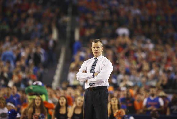 Florida coach Billy Donovan looks over to the UConn bench during their NCAA Final Four game against UConn at AT&T Stadium in Arlington, TX on April 5, 2014. The Gators lost the game 63-53.(Jacob Langston/Orlando Sentinel)