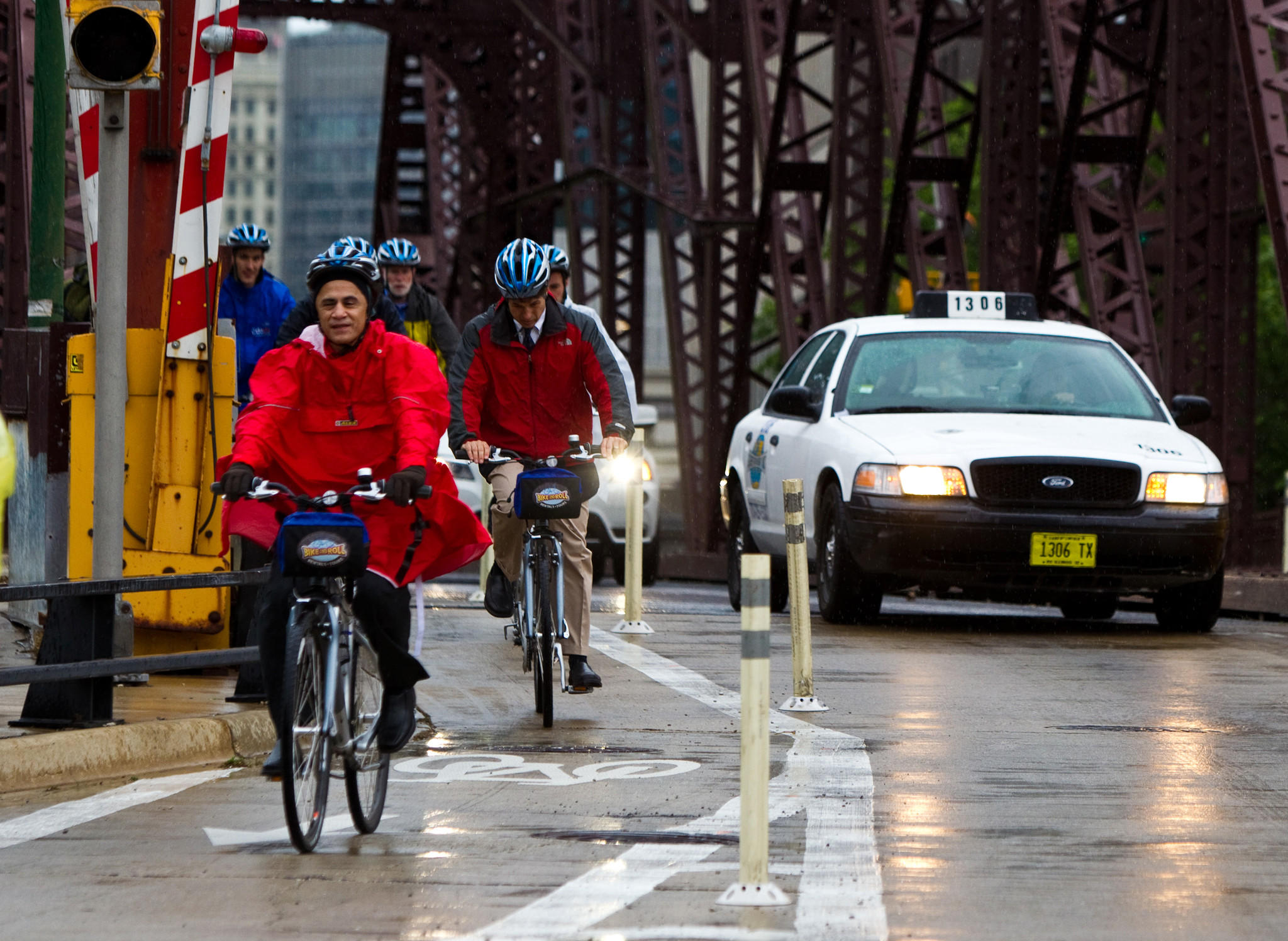 Bicyclists ride along the protected bike lane along Kinzie Street in Chicago.