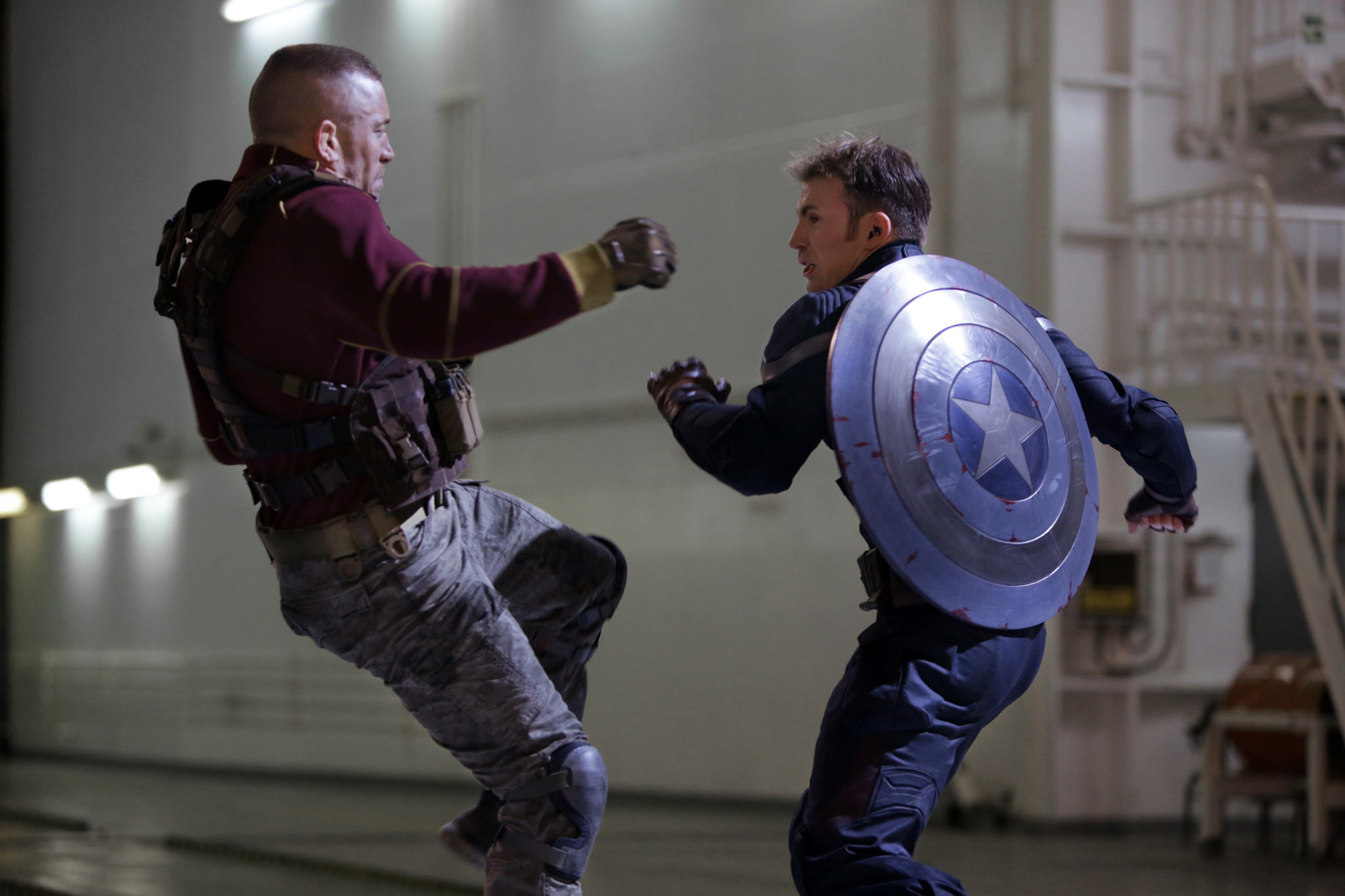 """This image released by Marvel shows George St-Pierre, left, and Chris Evans in a scene from """"Captain America: The Winter Soldier."""""""