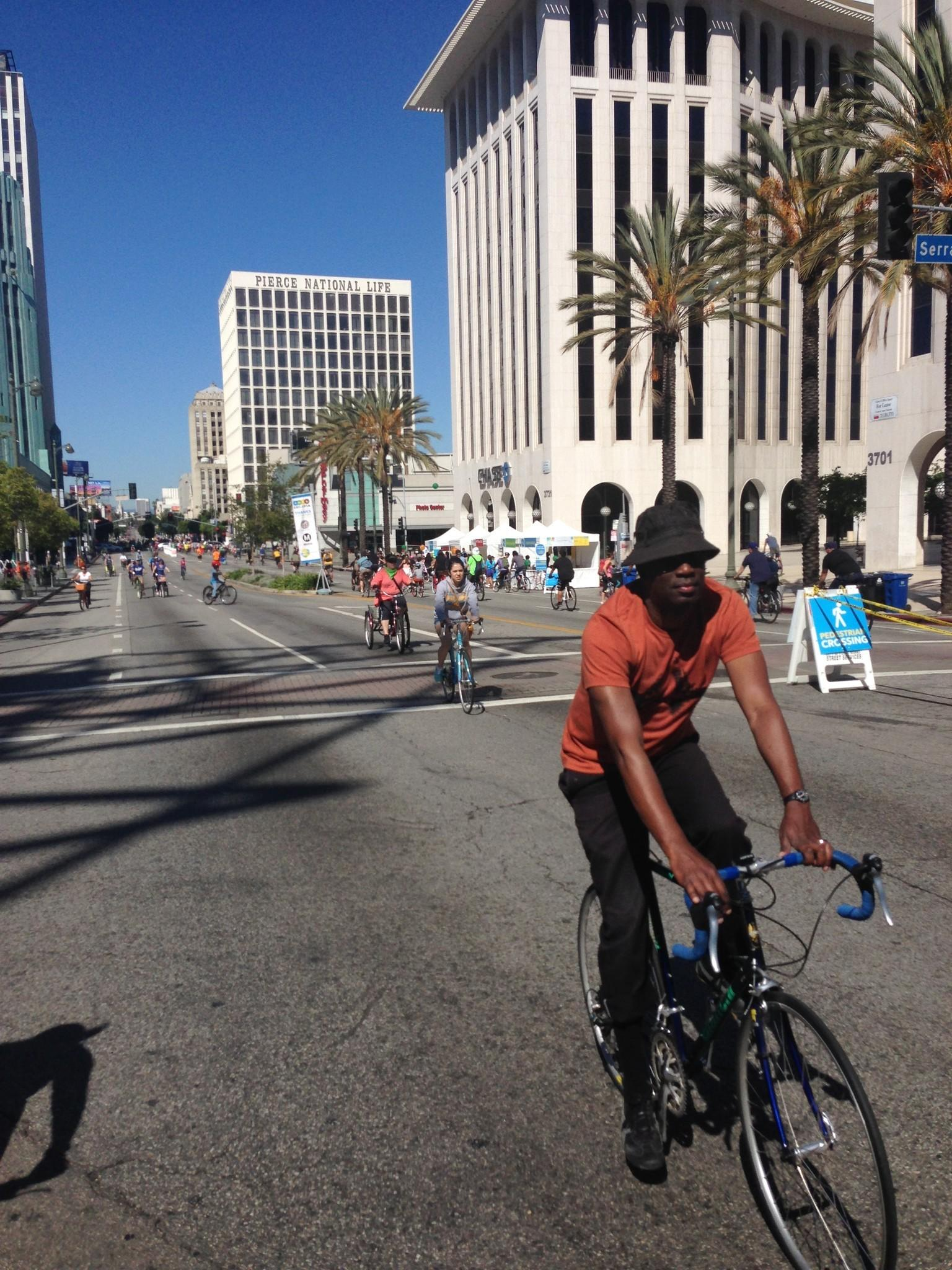 Cyclists make their way down Wilshire Boulevard in Koreatown.