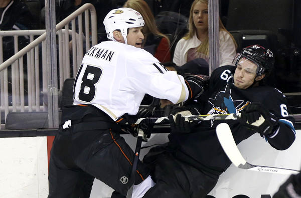 Ducks forward Tim Jackman checks Sharks defenseman Justin Braun along the boards in a game last month in San Jose.