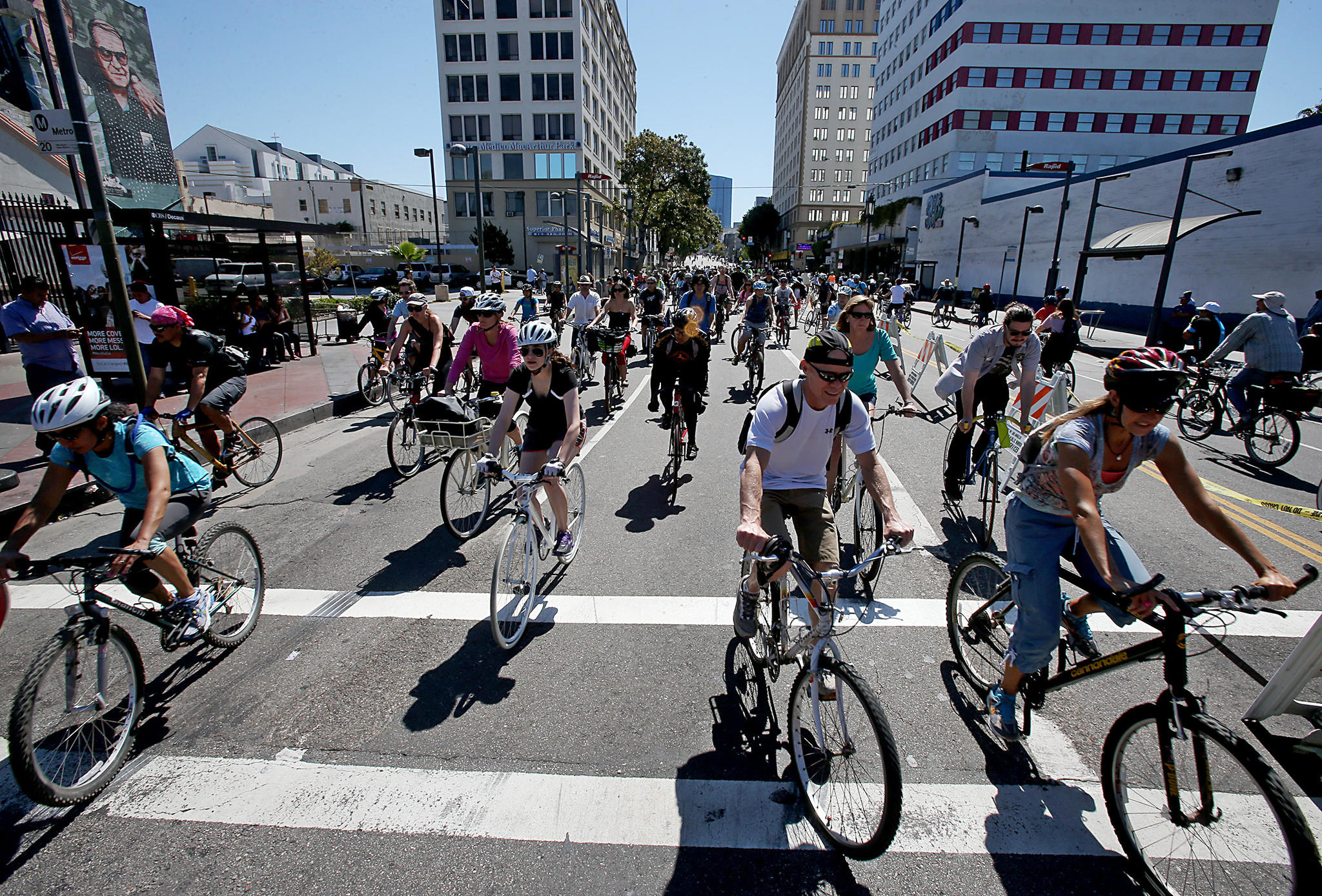 Bicyclists stream through the intersection of Alvarado Street and Wilshire Boulevard in Los Angeles as they participate in the annual CicLAvia bike festival on Sunday.