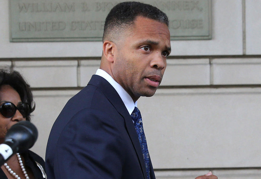 Jesse Jackson Jr. and his wife Sandi Jackson depart after their sentencing hearing Wednesday, Aug. 14, 2013, at E. Barrett Prettyman Federal Courthouse in Washington, D.C.