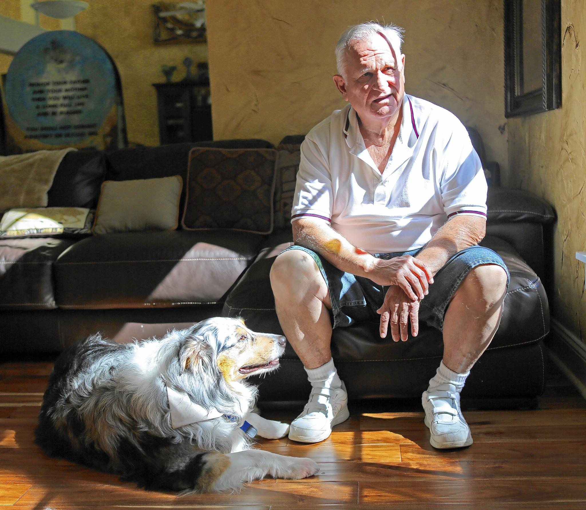 Lake Mary resident Allen Bradley, 74, with his dog, Israel.