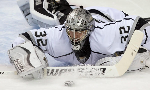 Kings goalie Jonathan Quick makes a save during a 2-1 loss to the Vancouver Canucks on Saturday. Quick and the Kings will enjoy a three-day break before embarking on the final three games of the regular season.