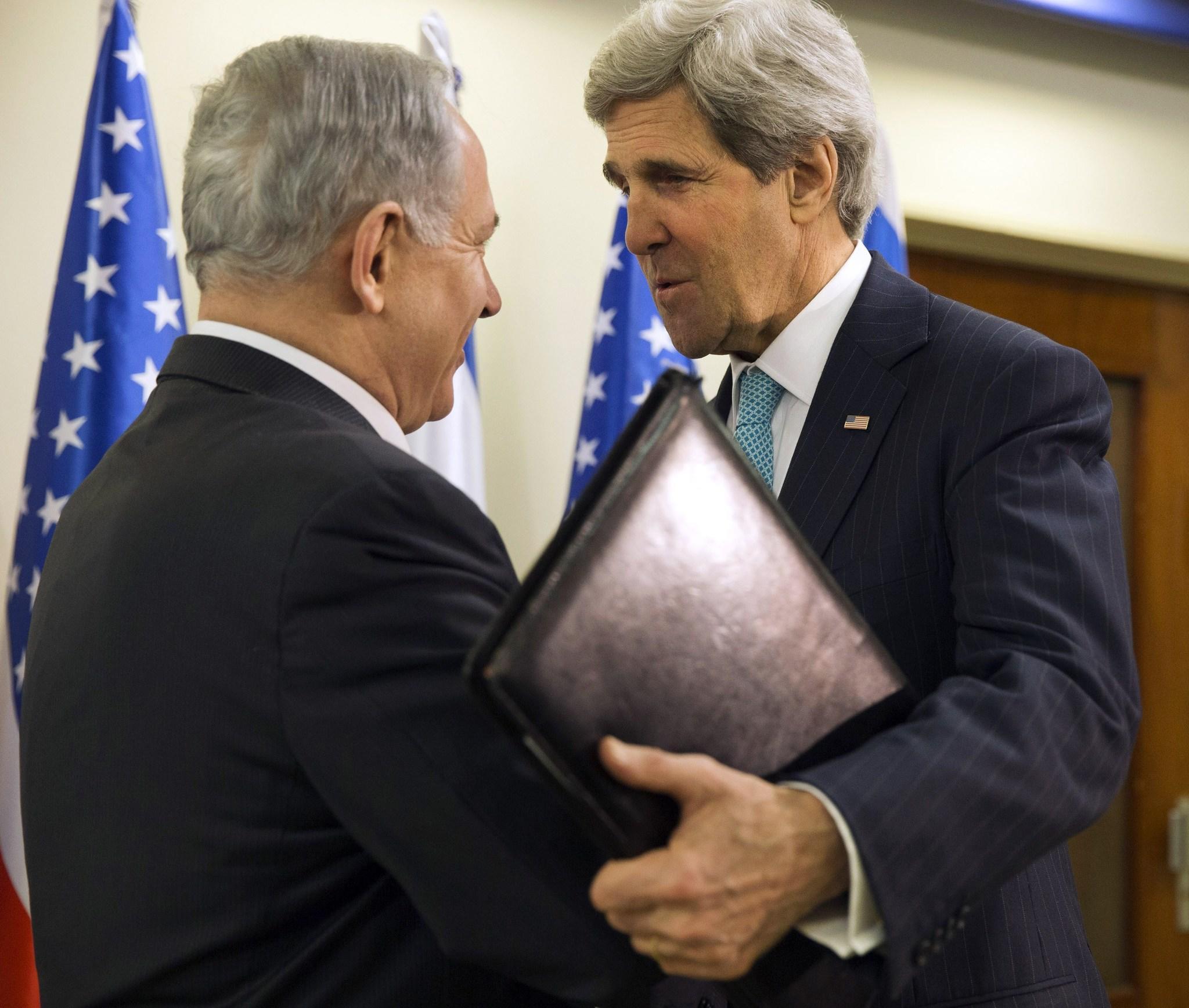 Israeli Prime Minister Benjamin Netanyahu welcomes US Secretary of State John Kerry (R) in Jerusalem March 31, 2014.