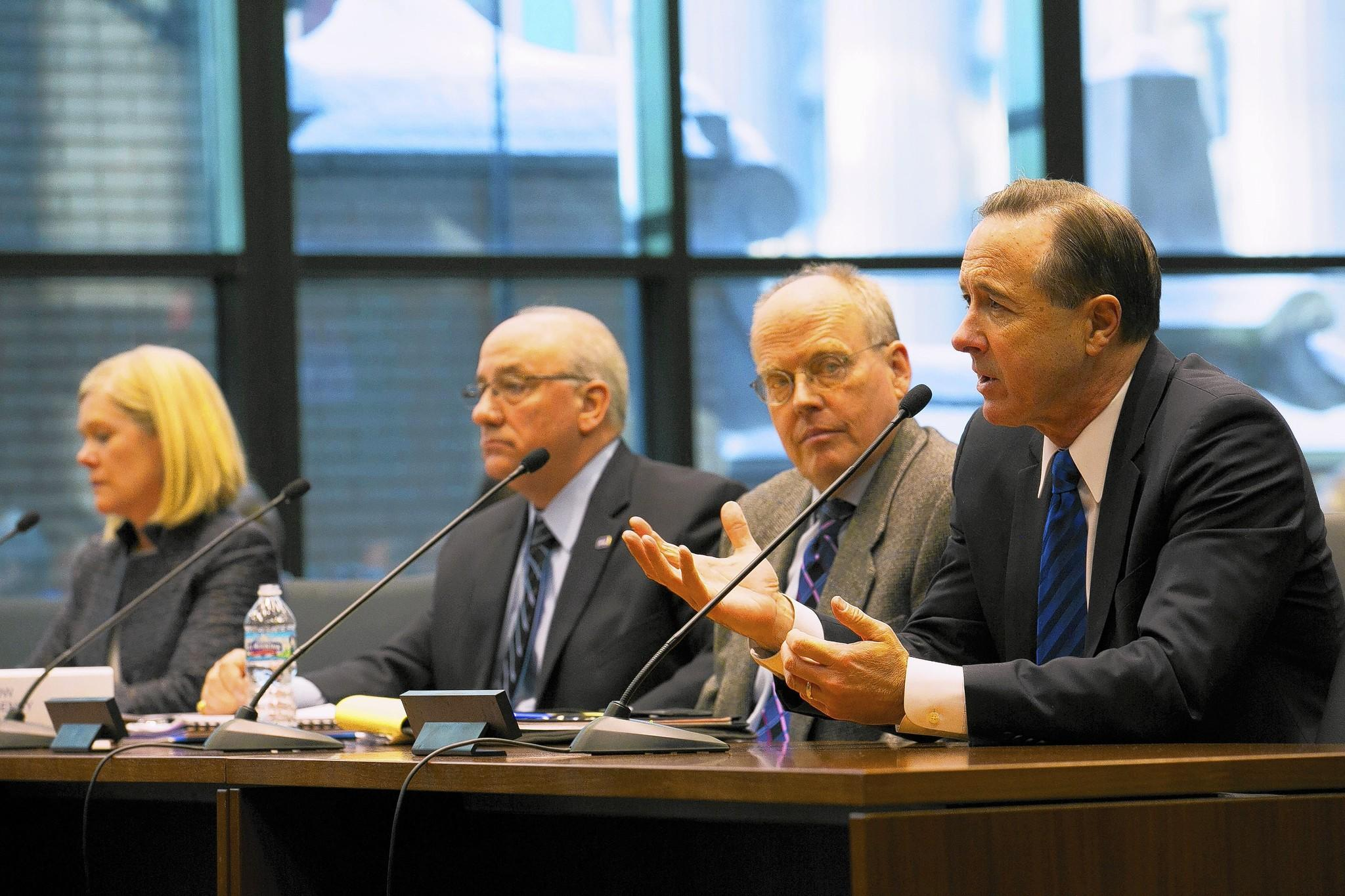 CTA President Forrest Claypool, right, speaks in February to an Illinois House transit panel with, from left, Leanne Redden, RTA senior executive director of planning; Don Orseno, Metra CEO; and Pace Executive Director T.J. Ross.