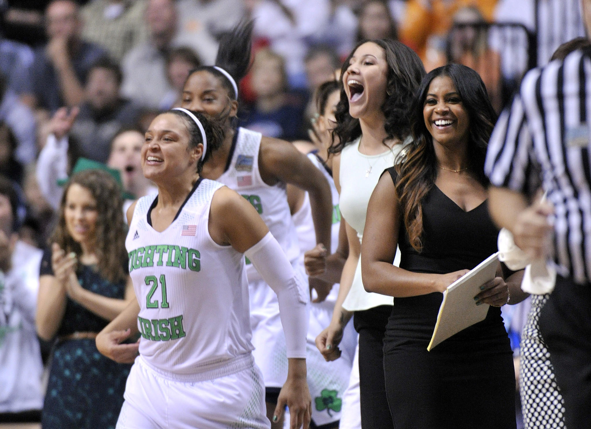 Notre Dame's Kayla McBride (21) and her teammates celebrate winning the game against Maryland.