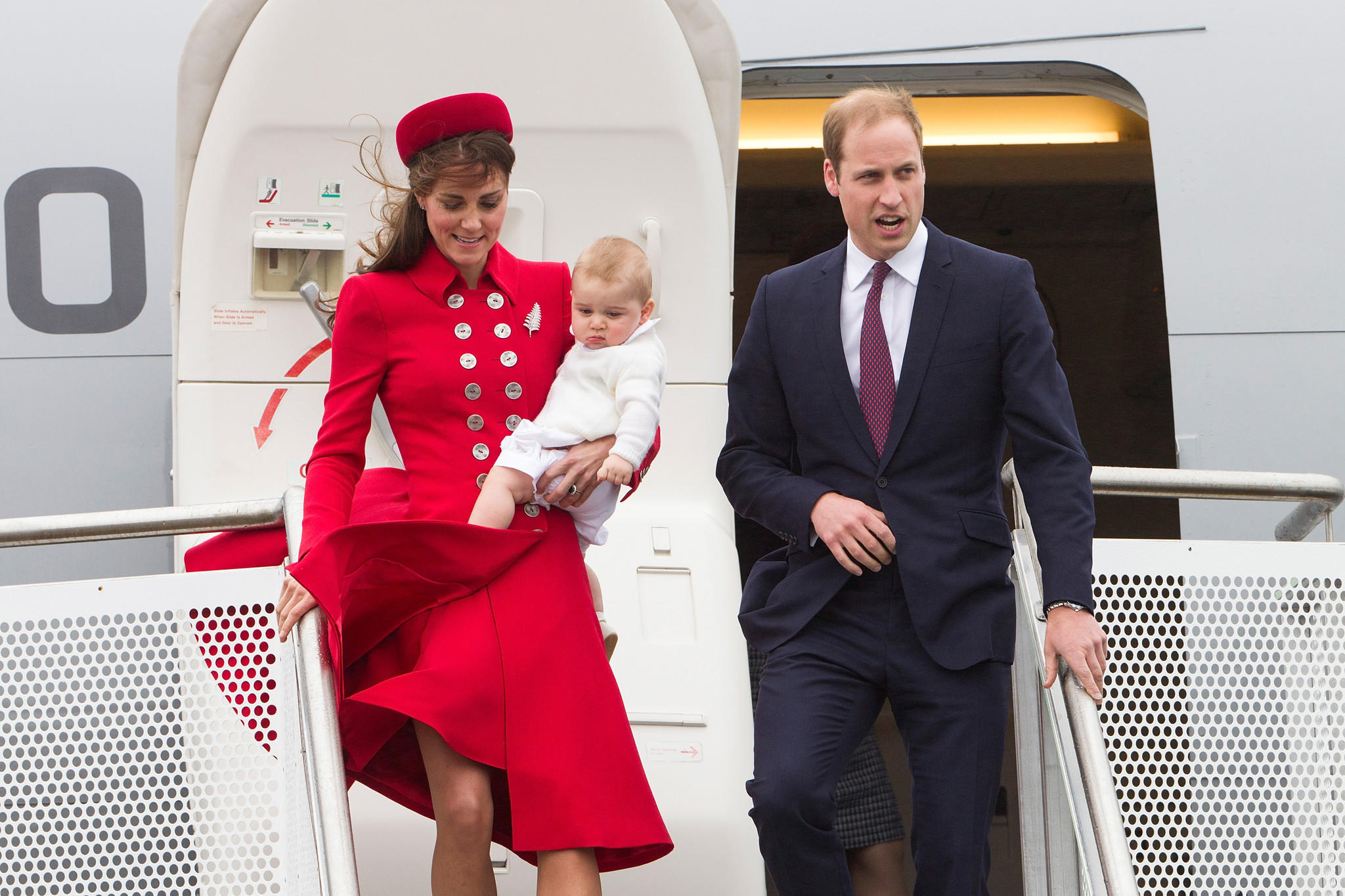 The duke and duchess of Cambridge with Prince George arrive at Wellington Military Terminal, Wellington, New Zealand.