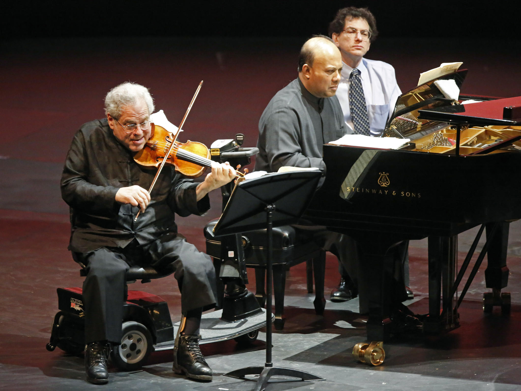 (Left to right)Violinist Itzhak Perlman and pianist Rohan De Silva, during their performance at the Civic Opera House in Chicago.