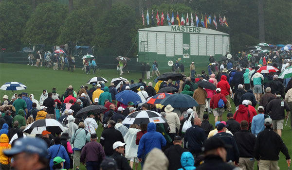 Patrons are evacuated from the Augusta National Golf Club course after play was suspended due to severe weather during a practice round for the Masters.