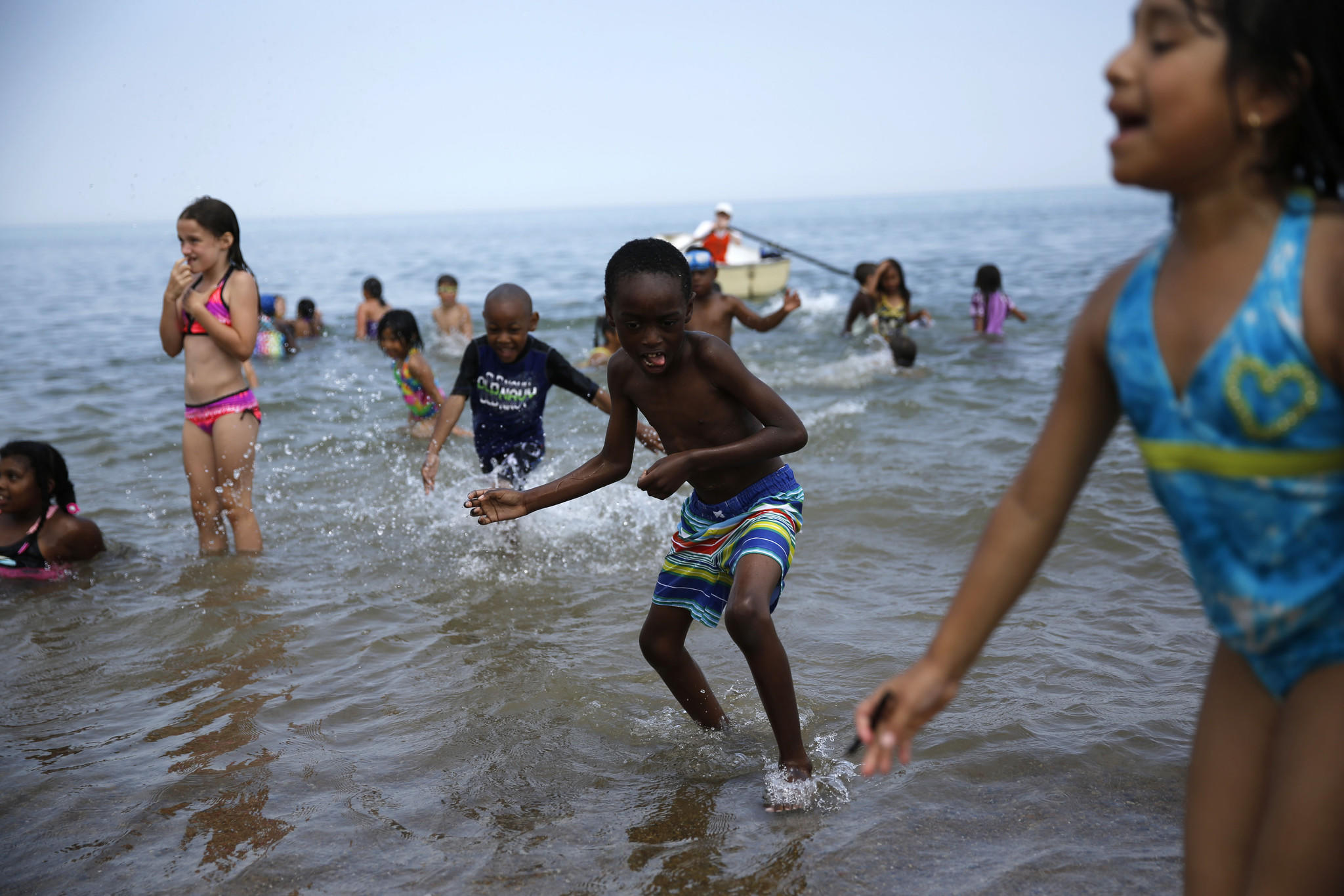 Children, ages ranging from 6-9 years old, from Loyola Park day camp play in the lake at Leone Beach in Chicago's Far North Side to keep cool on a hot summer day in July 2013.