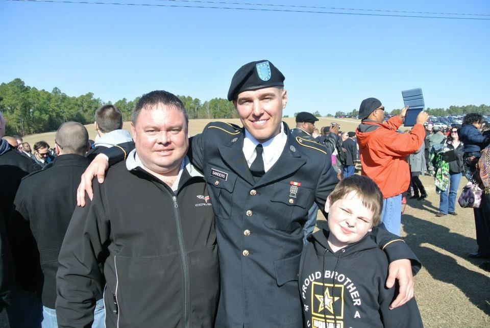 """Pvt. Jacob """"Jake"""" Sanders, center, told his father, Greg, left, how he attempted to save the life of Sgt. Timothy Owens, who was killed in the Ft. Hood shooting last week."""