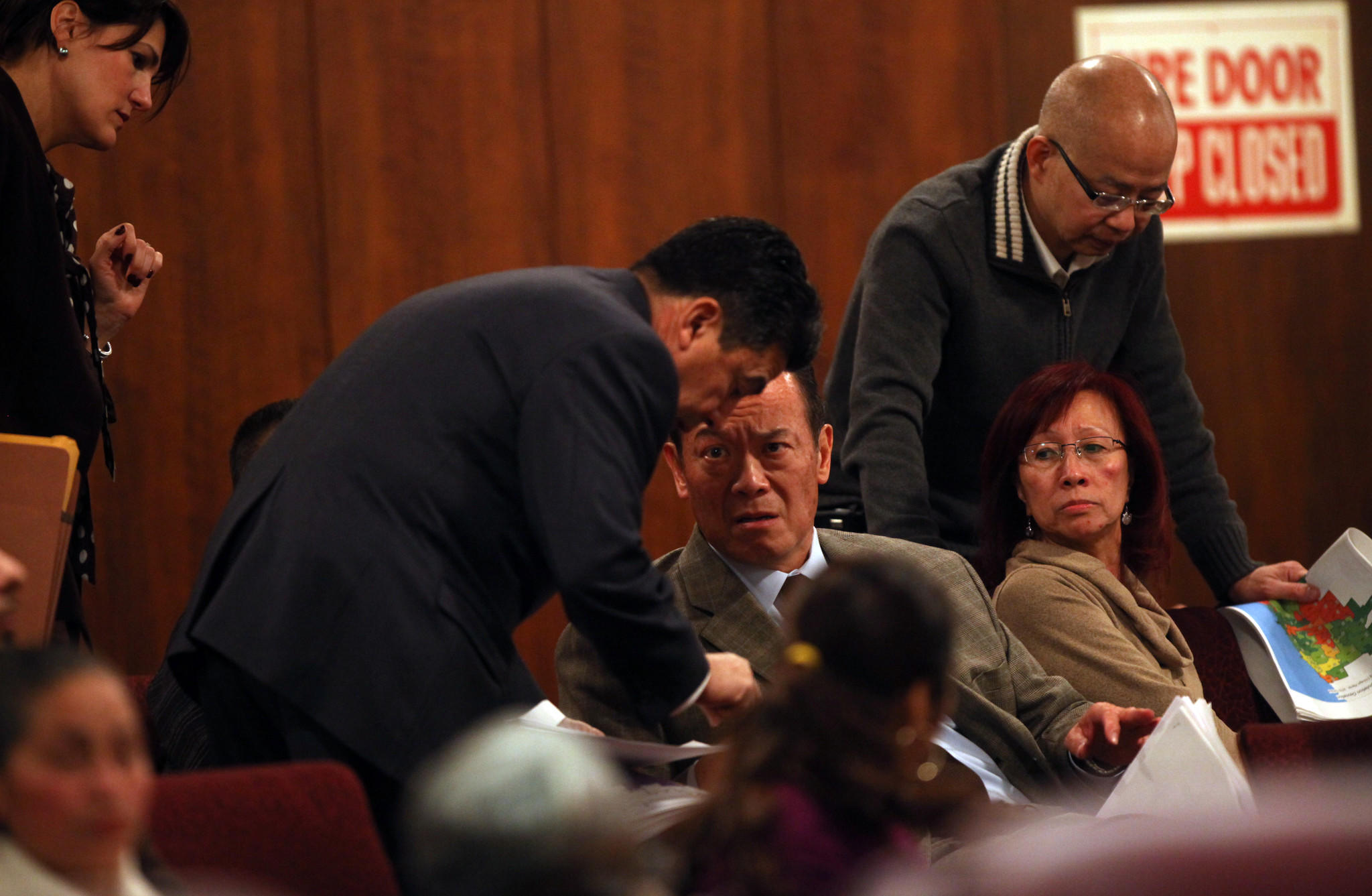 Ald. Daniel Solis, 25th, left, speaks with constituent Gene Lee, Chairman of the Chicago Chinatown Special Events Committee, during a hearing by the Chicago City Council Rules Committee Thursday Nov. 17, 2011 about city remapping.