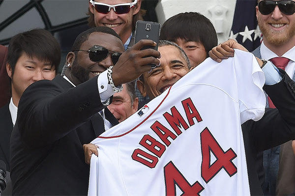 Boston designated hitter David Ortiz takes a selfie with President Obama during a ceremony at the White House.